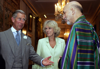 Britain's Prince of Wales greets Afghanistan's President Hamid Karzai as The Duchess of Cornwall looks ...