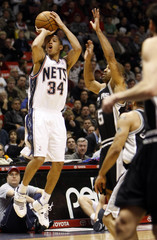 New Jersey Nets Harris shoots three against San Antonio Spurs Udoka in their NBA basketball game in East Rutherford