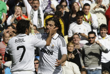 Real Madrid's Raul Gonzalez celebrates his goal against Valladolid with teammate Gonzalo Higuain during their Spanish first division soccer match at Madrid's Santiago Bernabeu stadium in Madrid