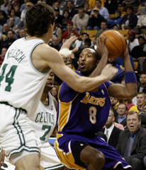 LAKERS BRYANT DEFENDED BY CELTICS WELSCH AND ATKINS.