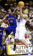 ORLANDO'S HILL IS FOULED BY TORONTO'S WILLIAMS.