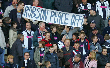 West Bromwich Albion fans hold up a banner ahead of their English Premier League soccer match against West Ham United in Birmingham
