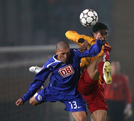 Hertha Berlin's Gimenez jumps for header with Galatasaray's Song during their friendly soccer match in Izmir