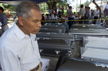 A RESIDENT OF CHILPANCINGO LOOKS AT THE CASKETS OF VICTIMS.