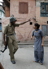 Kashmiri woman argues with Indian policeman during protest in Srinagar