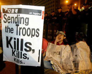 A SOUTH KOREAN PROTESTER SHOUTS SLOGANS AT AN ANTI-WAR AND ANTI-U.S. RALLY NEAR U.S. EMBASSY IN ...