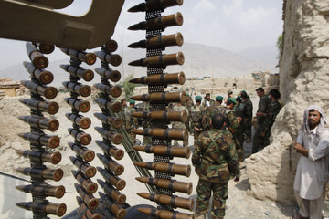 Afghan National Army soldiers stand in formation during a deployment ahead of Afghanistan's Presidential elections in their base near the village of Pashad