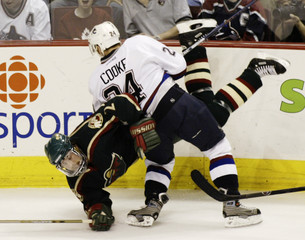 VANCOUVER CANUCKS COOKE CHECKS WILDS MITCHELL.