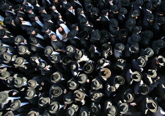 Thousands of ultra-Orthodox Jews join in the funeral journey of Shmuel Mett in Jerusalem.