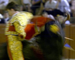SPANISH MATADOR MANOLO MARTINEZ TAKES A BACK-PASS TO THE BULL DURINGBULLFIGHT IN SEVILLE.