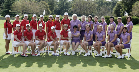 Solheim Cup team members from US and Europe pose for pictures for Solheim Cup golf tournament at Rich Harvest Farm in Sugar Grove