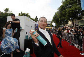 Adam Shankman holds a can of hair-spray at the premiere of Hairspray at the Mann Village theatre in Westwood