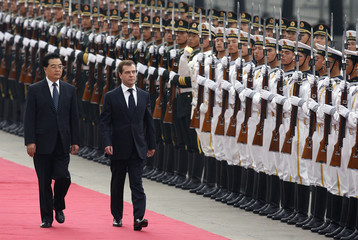 Chinese President Hu Jintao and Russia's President Dmitry Medvedev review the honour guard at the Great Hall of the People in Beijing