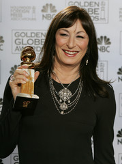 Anjelica Huston poses with her award at the 62nd Annual Golden Globe Awards.
