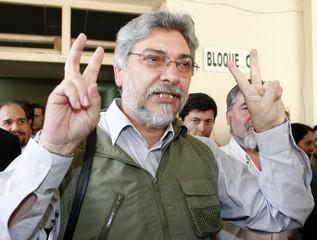 Former Paraguayan Roman Catholic bishop Fernando Lugo gestures to supporters in Asuncion