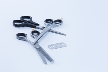Set of barber scissors and razor isolated on white background