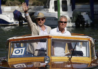Actor Castellitto waves as he arrives in a water taxi at the 66th Venice Film Festival