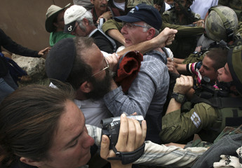 Leader of Jewish settlers scuffles with activist near Kiryat Arba
