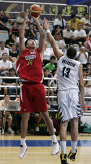 Wang shoots as Bradshaw tries to tackle him during a match of Continental Cup 2007 in Macau