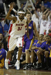 PISTONS RICHARD HAMILTON SIGNALS THREE POINTS AFTER HITTING SHOT AGAINST LAKERS.