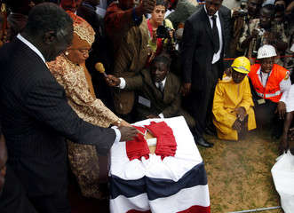 Ghana's President Kufuor and his Liberian counterpart Johnson-Sirleaf attend Liberia's Independence Day ceremony in Monrovia