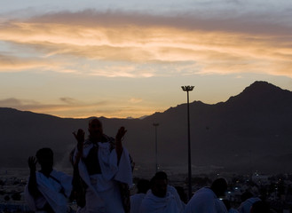Muslim pilgrims pray on Mount Mercy on the plains of Arafat outside the holy city of Mecca