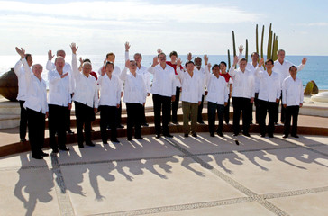 APEC LEADERS POSE FOR GROUP PHOTO IN LOS CABOS.