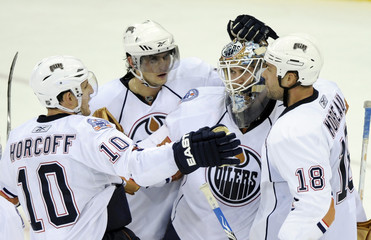 Edmonton Oilers goalie Jeff Drouin-Deslauriers celebrates with teammates after defeating the New Jersey Devils in Newark