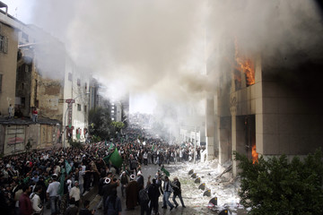 Lebanese Islamist demonstrators gather in front of the Danish consulate after setting fire to it in Beirut