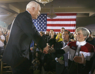 Presumptive Republican US presidential nominee Sen John McCain greets a supporter during a town meeting event at the Springfield Country Club in Springfield Pennsylvania