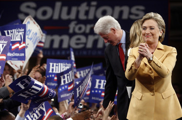 """Democratic presidential candidate Senator Clinton stands with her husband and former US President Bill Clinton at her """"Super Tuesday"""" primary election night rally in New York"""