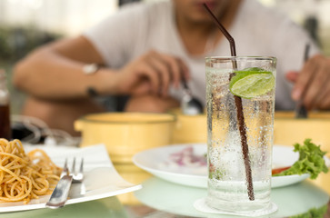 Man having glass of fresh sparkling mineral water