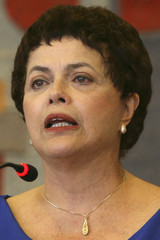 Brazil's Chief of Staff Rousseff shows her natural hair, after undergoing cancer treatment, during a launching ceremony of the Human Rights National Program in Brasilia