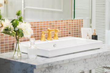 Modern faucet golden bathroom interior