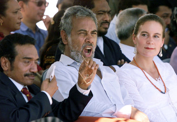 EAST TIMOR PRESIDENT XANANA GUSMAO YAWNS AS HE ATTENDS THE FIRSTANNIVERSARY OF EAST TIMOR'S ...