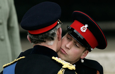 Britain's Prince William kisses his father Britain's Prince Charles after the Sovereign's Parade at the Royal Military Academy in Sandhurst