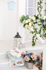 Vintage wooden lanterns and patterned pillows. Spring pretty background. Spring and Easter mood. Shabby chic style