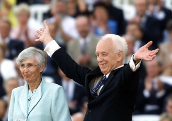 Hungary's new president Ferenc Madl waves to people next to his wife Dalma after his inauguration on..