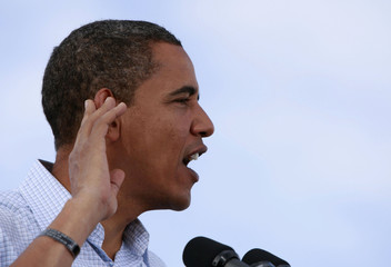 U.S. Democratic presidential nominee Obama listens for a response from crowd at a rally in Henderson