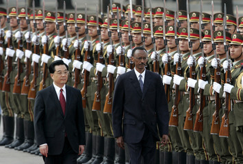 China's President Hu Jintao and Rwanda's President Paul Kagame view an honor guard in Beijing