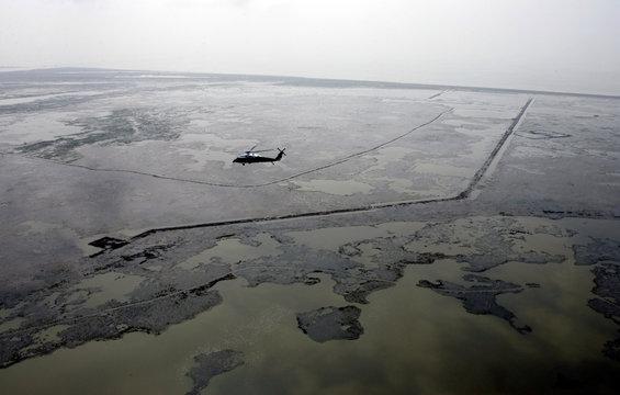 US President Bush aboard Marine One flies over an area of coastline devastated by Hurricane Rita in Cameron county