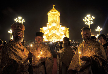 Priests attend a midnight Easter mass in Tbilisi