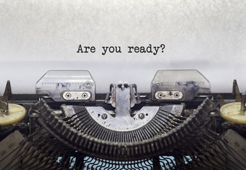Vintage typewriter on white background with text Are you ready?