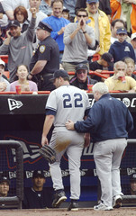 YANKEES CLEMENS GETS ESCORTED OFF THE FIELD AFTER AN INJURY.