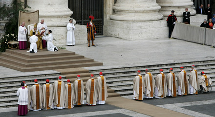 Newly elevated cardinals stand in line to receive rings from Pope Benedict XVI during special mass at Vatican