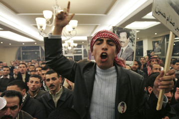 An Iraqi man shouts during a protest against the execution of former Iraqi President Saddam in Amman