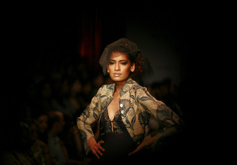 A model presents a creation by Indian designer Bal at a fashion show in New Delhi
