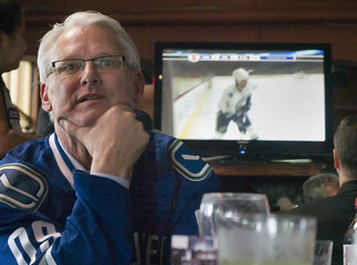 British Columbia Premier Gordon Campbell watches Canuck's and Blackhawks play NHL playoffs in Port Moody