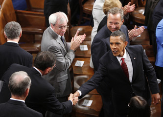 U.S. President Barack Obama shakes hands on the floor after delivering a speech on healthcare reform before a joint session of Congress in Washington