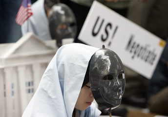 A woman wears a mask at an anti-U.S. protest near the U.S. embassy in Seoul